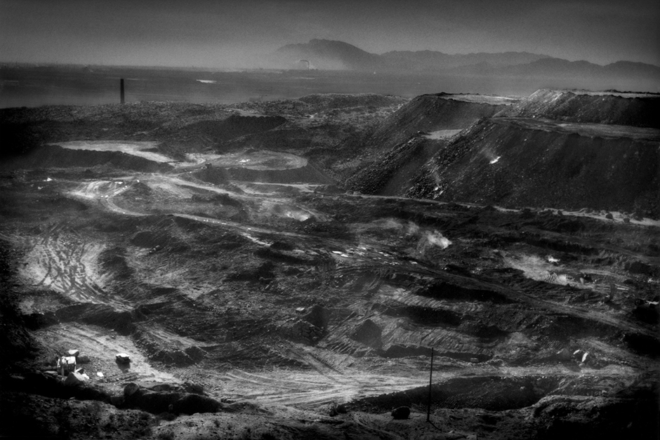 Open-pit coal mine on the back side of a Buddhist temple mountain in Laoshidan, Inner Mongolia. China produces more coal than the United States, the European Union, and Japan combined, and China consumes three times as much coal as the U.S.