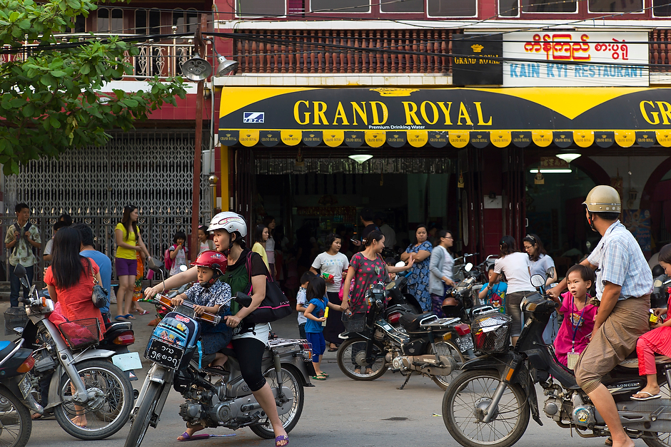 Chinese parents pick up their children outside a Chinese restaurant in downtown Mandalay. While ethnic Chinese have resided in Myanmar for several generations, the growing number of Chinese coming to the country over the past decade has caused disquiet and anti-Chinese sentiment among Burmese.