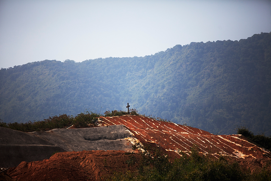 A cross stands on a slope near the site of the planned Myitsone dam. Christian churches in the area planted crosses on the construction site in northern Kachin State, despite the Burmese government's warnings to stop doing so.