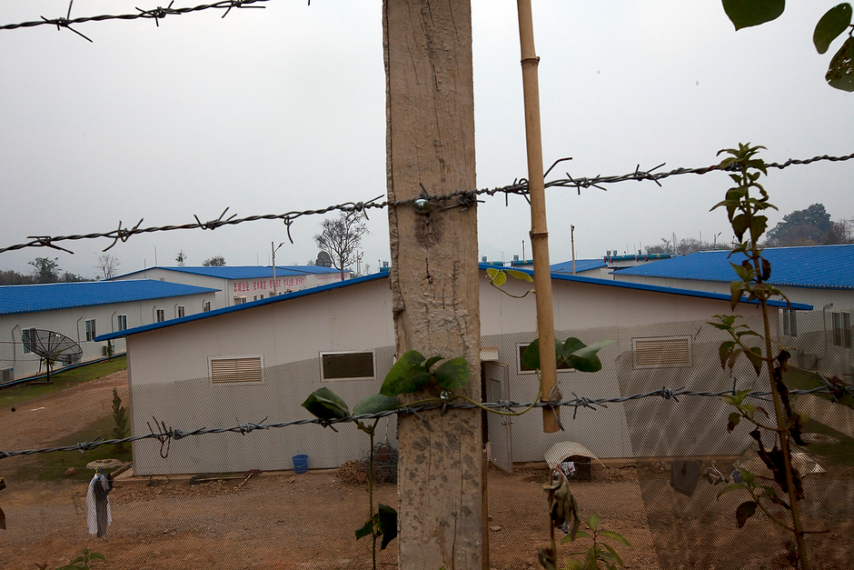 Barbed wire surrounds a dormitory that houses Chinese workers for China National Petroleum Corporation's $2.5 billion oil and gas pipeline near the mountain towns of Hsipaw and Ban Nay Village. The 1,700-mile pipeline cuts across Myanmar, taking oil and gas into China.