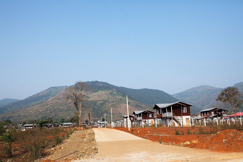 Simple two-story homes stand in neat rows at the model resettlement camp of Aung Myin Thar. The resettlement camp, which contains about two dozen homes, was built to house the villagers of Tang Phare.