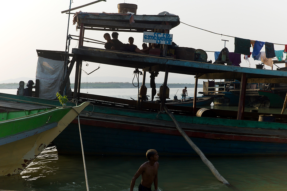 An evening river scene at the docks of the Mandalay jetty, along the Irrawaddy River.