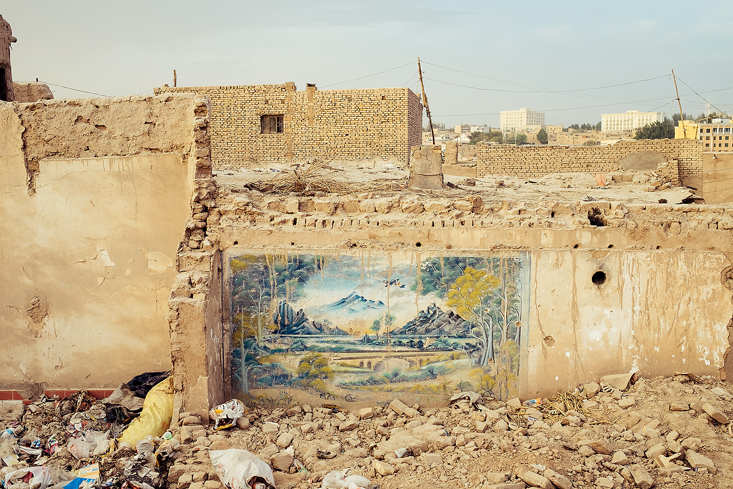 In the late 2000s, the government demolished much of Kashgar's Old City, angering many locals.  More recently, the local government is saving some of the Old City's traditional high platform houses to turn them into tourist attractions.