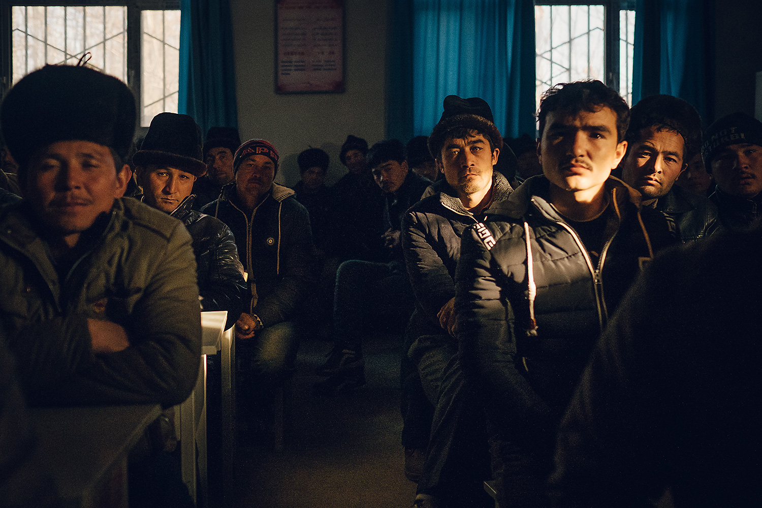 Uighur villagers attend a weekly presentation, led by local Uighur cadres, to discuss development projects. The government hopes that economic development will quell separatism.