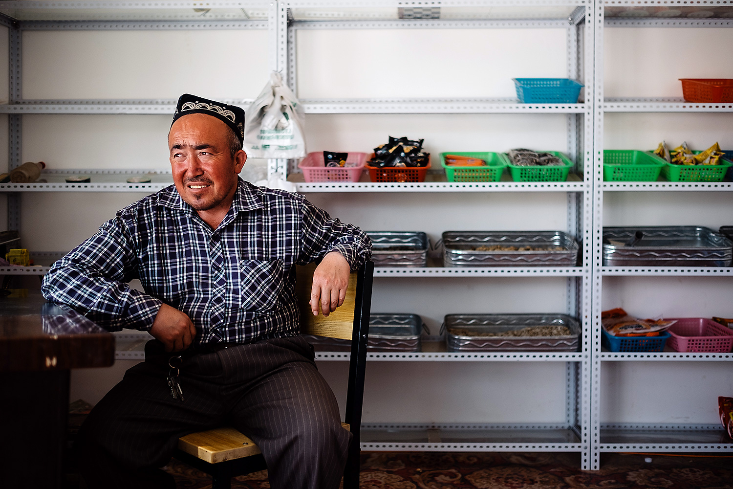 A former farmer, Tursun, who only gave his first name, tends a small shop he set up near what used to be his fields in Guangzhou New City.