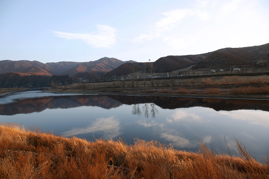 The Tumen River forms a natural border between North Korea, seen across the water, and China, October 2008.