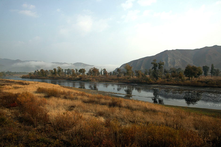 The Tumen River marks the border between North Korea and China. Many of the refugees who cross it wait until the winter months when freezing temperatures make for easier passage. October 2007.