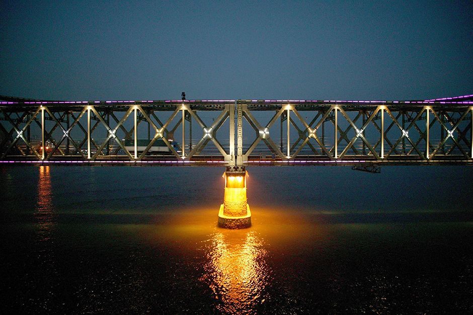 A truck crosses the Friendship Bridge that connects the city of Dandong, China and the city of Sinuiju, North Korea, October 2008. The bridge, like other channels that connect China and North Korea, also is used as a means to repatriate North Korean refugees caught in China.