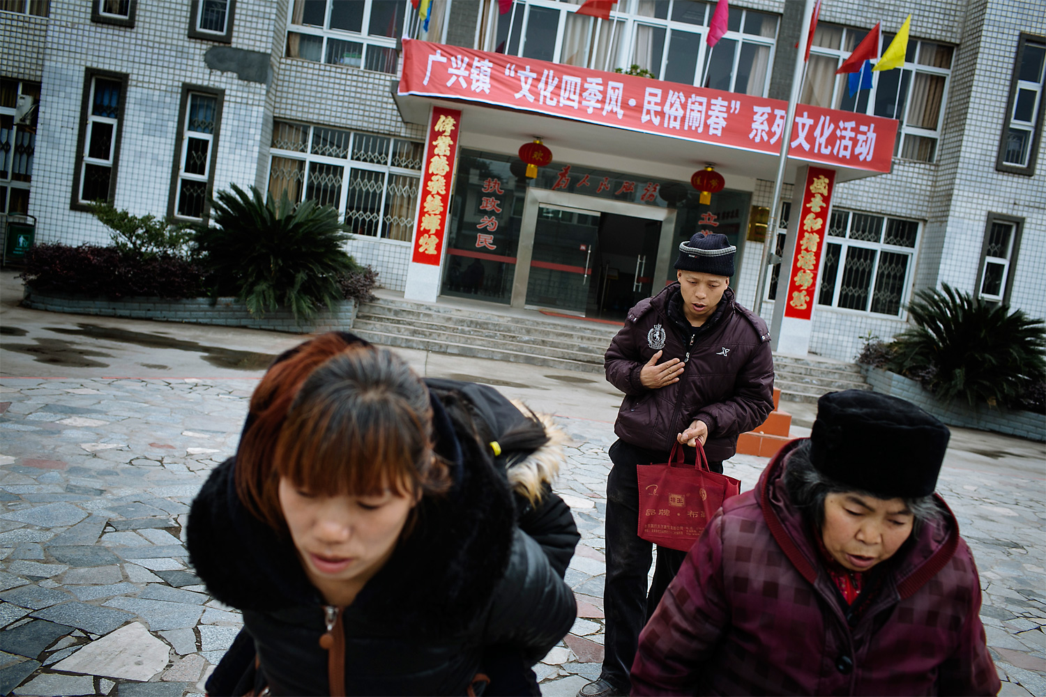 Li Mingjin and his family leave the local government offices, after a meeting to ask for financial help. The local government officials didn't give a clear answer, saying instead that there are many cases like Li's in the town.
