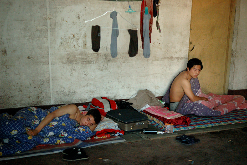 Another morning begins with Tianjun and Qin waking up after spending a night on thin mats rolled out on the floor. Their day usually starts at six o'clock in the morning and finishes around midnight. When they are not sleeping in municipal buildings lent to them by village committees, troupe members can sometimes pay villagers in coal in exchange for a place to rest for the night.