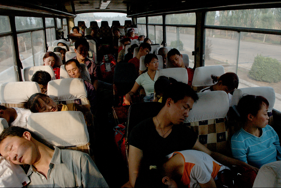 Asleep while in motion, performers stretch out on a bus bound for the next destination, four hours away. They rarely travel beyond the borders of Shanxi, as their style of opera is specific to the region. Nevertheless, the distances are long and most troupe members only see their families once a year, during the Spring Festival.