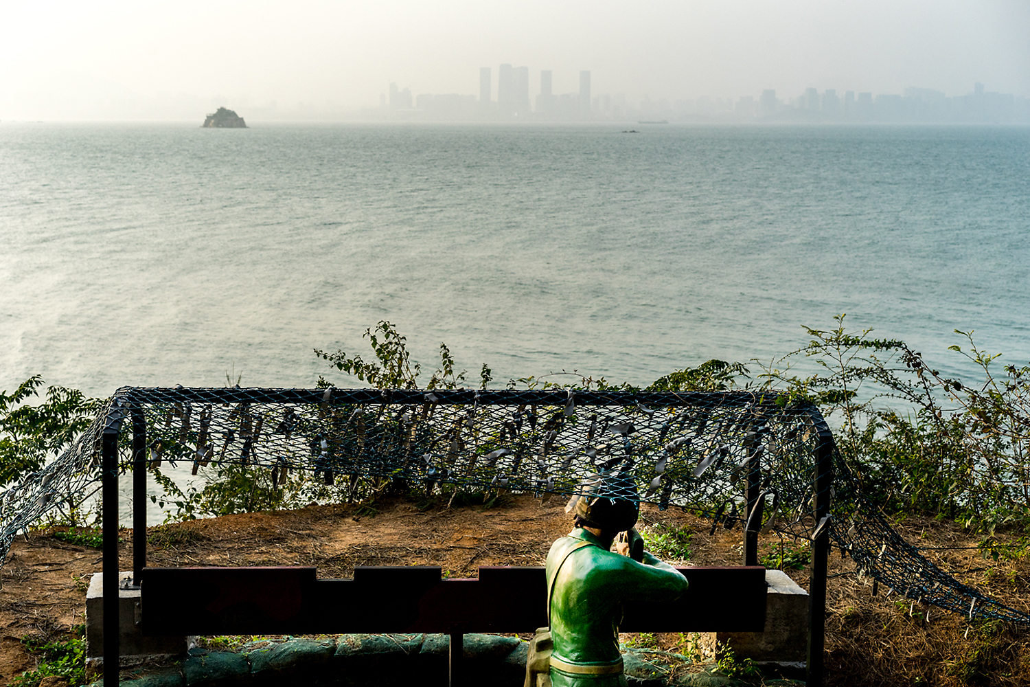 A statue of a soldier faces the waters beyond Lieyu Island, also known as Little Kinmen, a short ferry ride from Kinmen proper. This island is a tourist stop for visitors interested in the military history of the region, where young Taiwanese soldiers used to deploy along Kinmen's coast to watch for enemy 'frogmen' from China.
