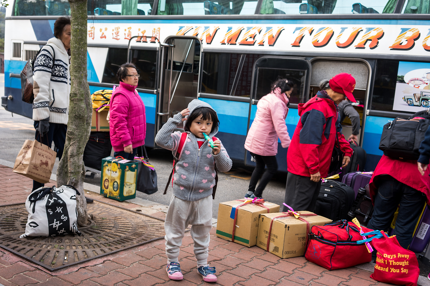 A tour group gathers its luggage from a bus at Shuitou Ferry Terminal in Kinmen, preparing to catch a ferry to Xiamen. In the years following the end of military rule in Kinmen, the local government and residents have tried to draw more tourists from China—their one-time enemy. More than 750,000 tourists visited the islands in 2014, more than five times the local population of about 128,000. Tourists from mainland China accounted for nearly a third, up 41 percent from the previous year.