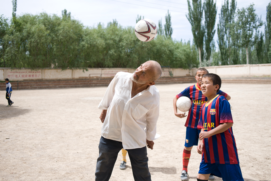 Tursun Qurban, 68, coaches soccer at Azak Township's Central Elementary School, near Artux. When he was young, Tursun was an accomplished soccer and volleyball player. One of his greatest wishes is to someday visit Ergong Stadium in the provincial capital Urumqi to watch professional soccer.