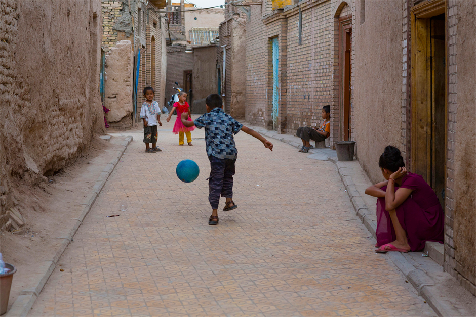 An alleyway in the old part of Kashgar, where soccer is one of the abiding passions of the city's youth.