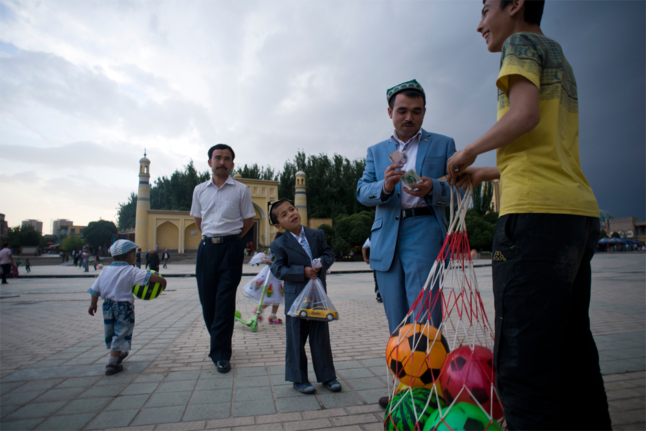 Every day on the plaza in front Kashgar's Id Kah Mosque children play soccer and sell soccer balls.