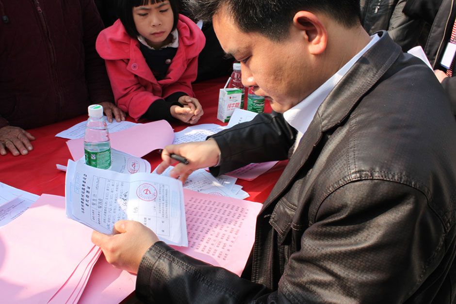 A voting official prepares absentee ballot voting certificates in Wukan, January 31, 2012.