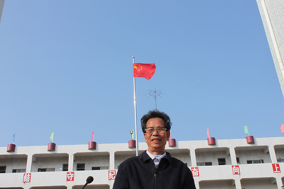 Lin Zuluan stands outside a school in Wukan, February 1, 2012.