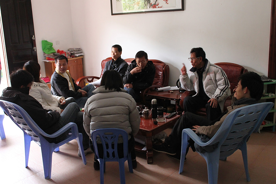 Activists meet in the private home of Lin Zuluan (second from right) in Wukan, January 6, 2012. Counterclockwise from Lin Zuluan are: Sun Wenliang, Yang Semao, Cai Yifeng, Hong Ruiqing, Hong Ruichao, Chen Suzhuan, Zhang Jianxing.