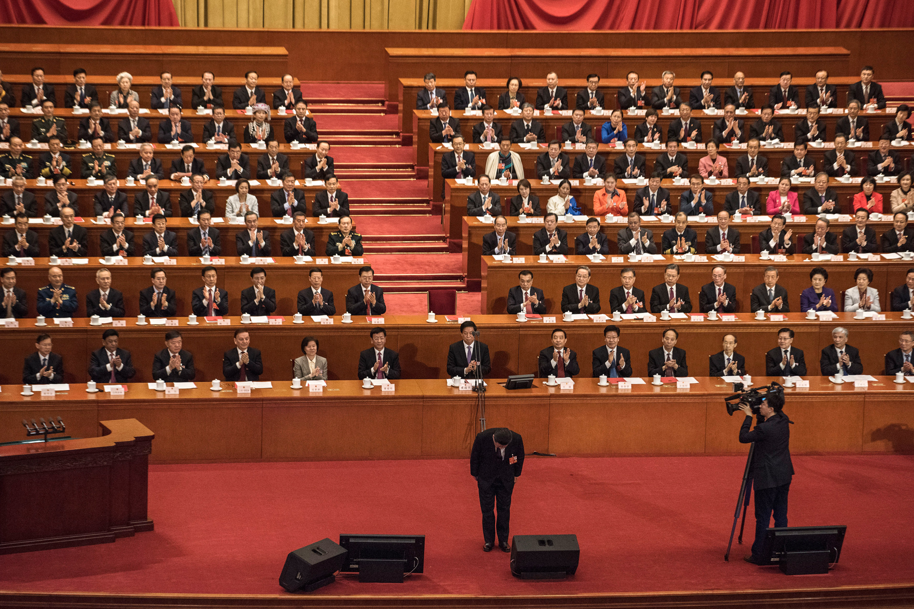 China's President Xi Jinping bows before his speech during the closing session of the National People's Congress at the Great Hall of the People in Beijing, March 20. Legislators passed an amendment to abolish the two-term limit of the presidency, opening the door for Xi, who is also General Secretary of China's Communist Party, to rule in perpetuity. (Kevin Frayer/Getty Images)