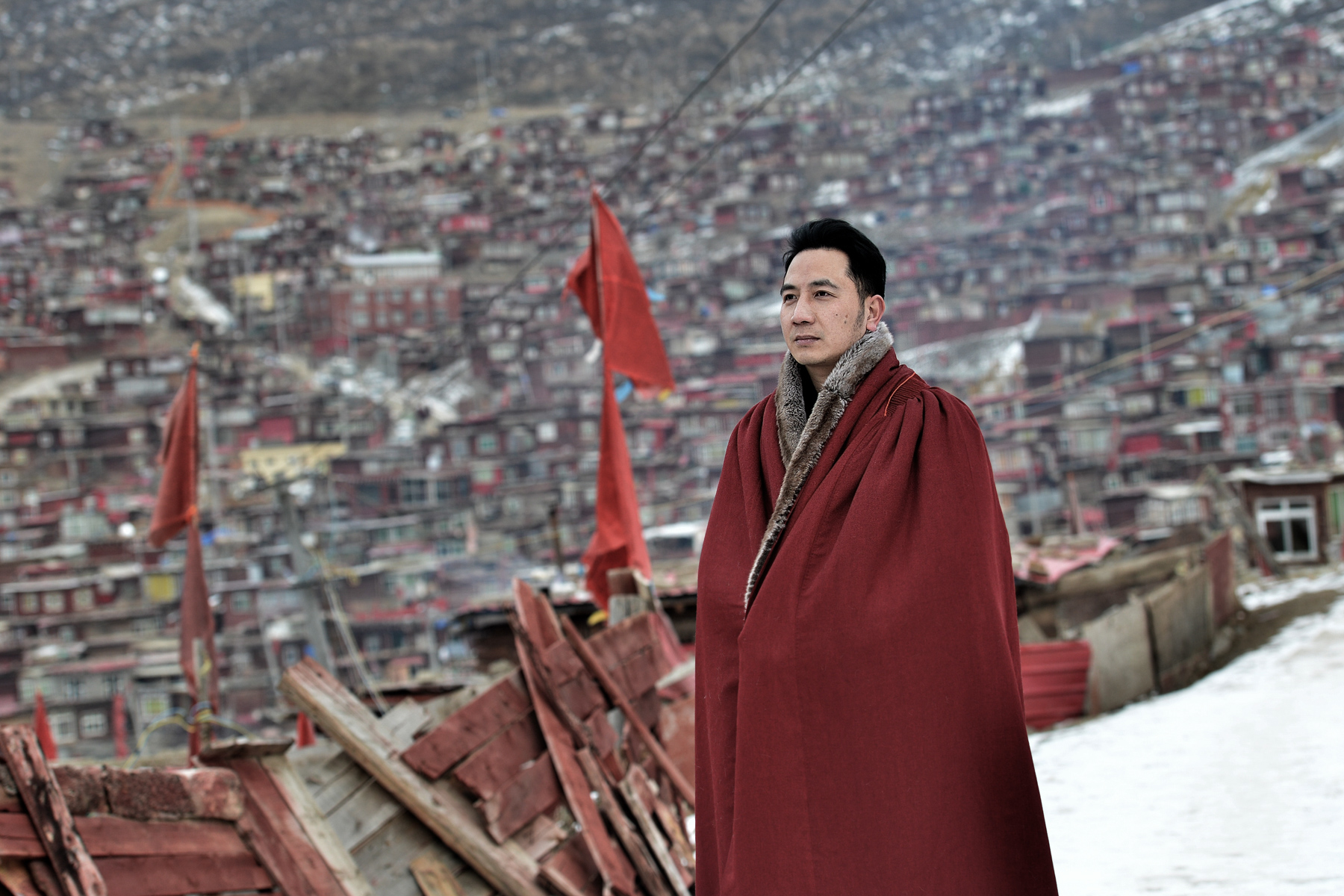 Lin Shengbin, whose wife and children died in an arson attack, takes a walk at the Larung Gar Buddhist Academy, in Sertar county, Tibet Autonomous Region, January 6. In June 2017, Lin's nanny, Mo Huanjing, deep in gambling debt, made a plan to set fire to her employer's home and then extinguish it, hoping the family would reward her financially. The fire killed Lin's three children and wife. Mo was sentenced to death and Lin, tormented by his loss, converted to Buddhism. (Li Qizheng/Sina)