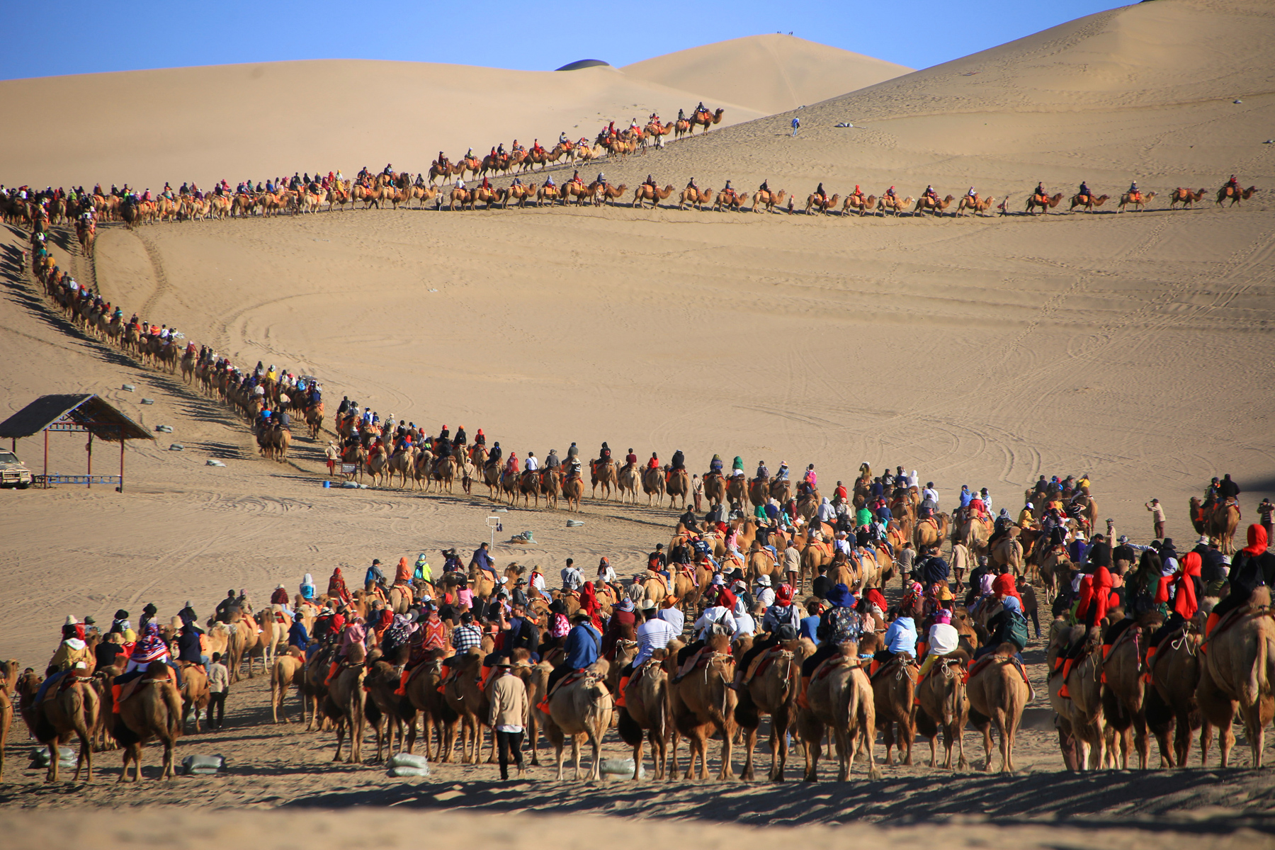 Tourists ride camels on Mingsha Mountain in Dunhuang, Gansu province, during China's National Day holiday, October 2. Dunhuang, an oasis in the Gobi desert, was a major center of international trade, art, and commerce on the Silk Road, as well as a religious pilgrimage site. (The Yomiuri Shimbun/AP Photo )