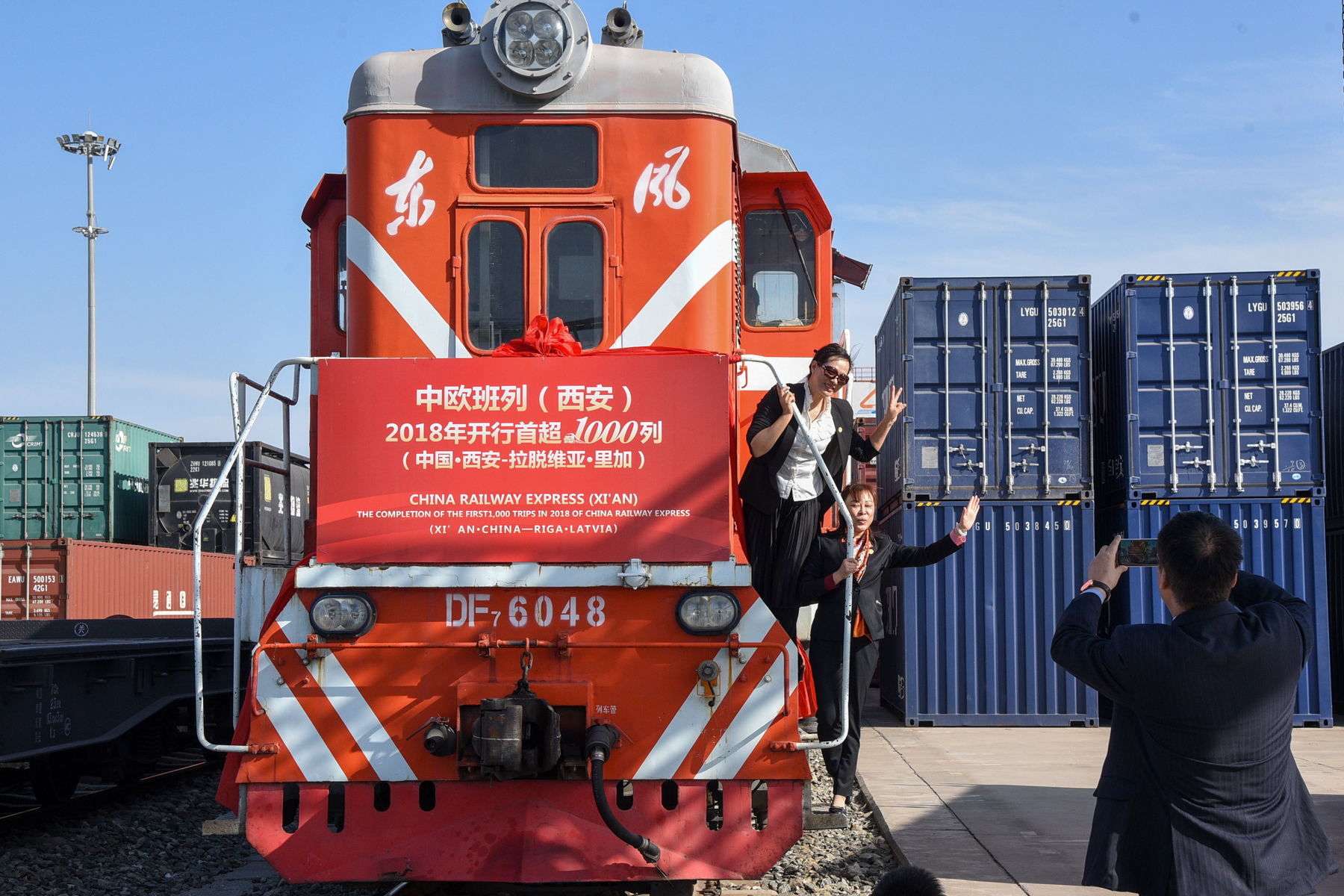 A freight train departs Xi'an for the Latvian capital of Riga during a ceremony to mark the 1,000th Europe-bound rail trip from Xi'an of the year, Shaanxi province, October 30, 2018. The vast railway network China has laid across Central Asia is a key element of China's ambitious Belt and Road Initiative. (Lao Qiang/ImagineChina)