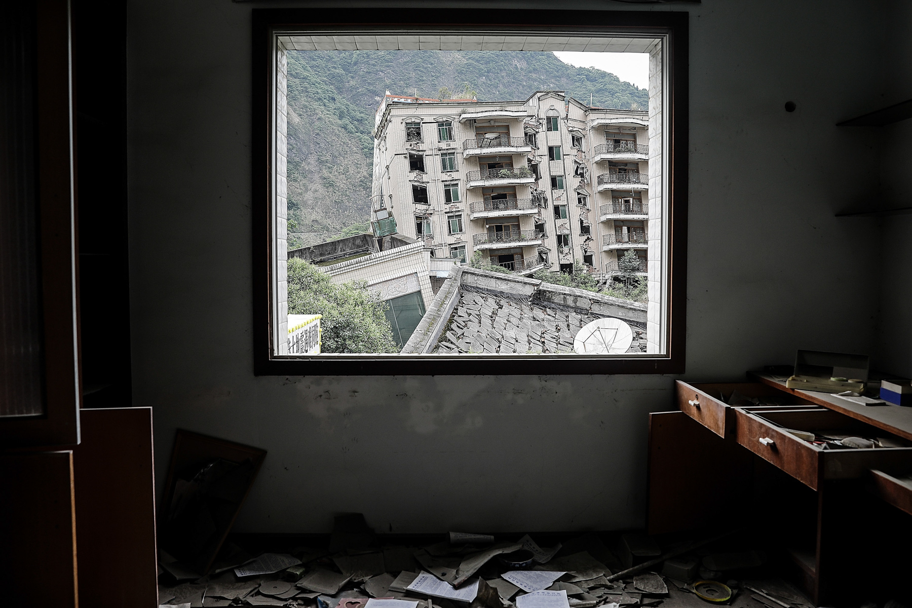 Buildings that were destroyed during the 2008 Sichuan Earthquake are seen from the window of another ruined building, in Beichuan Qiang Autonomous County, Sichuan province, May 11. May 12th marked the 10-year anniversary of the catastrophic Sichuan Earthquake that killed more than 15,000 people. (Wang He/Getty Images)