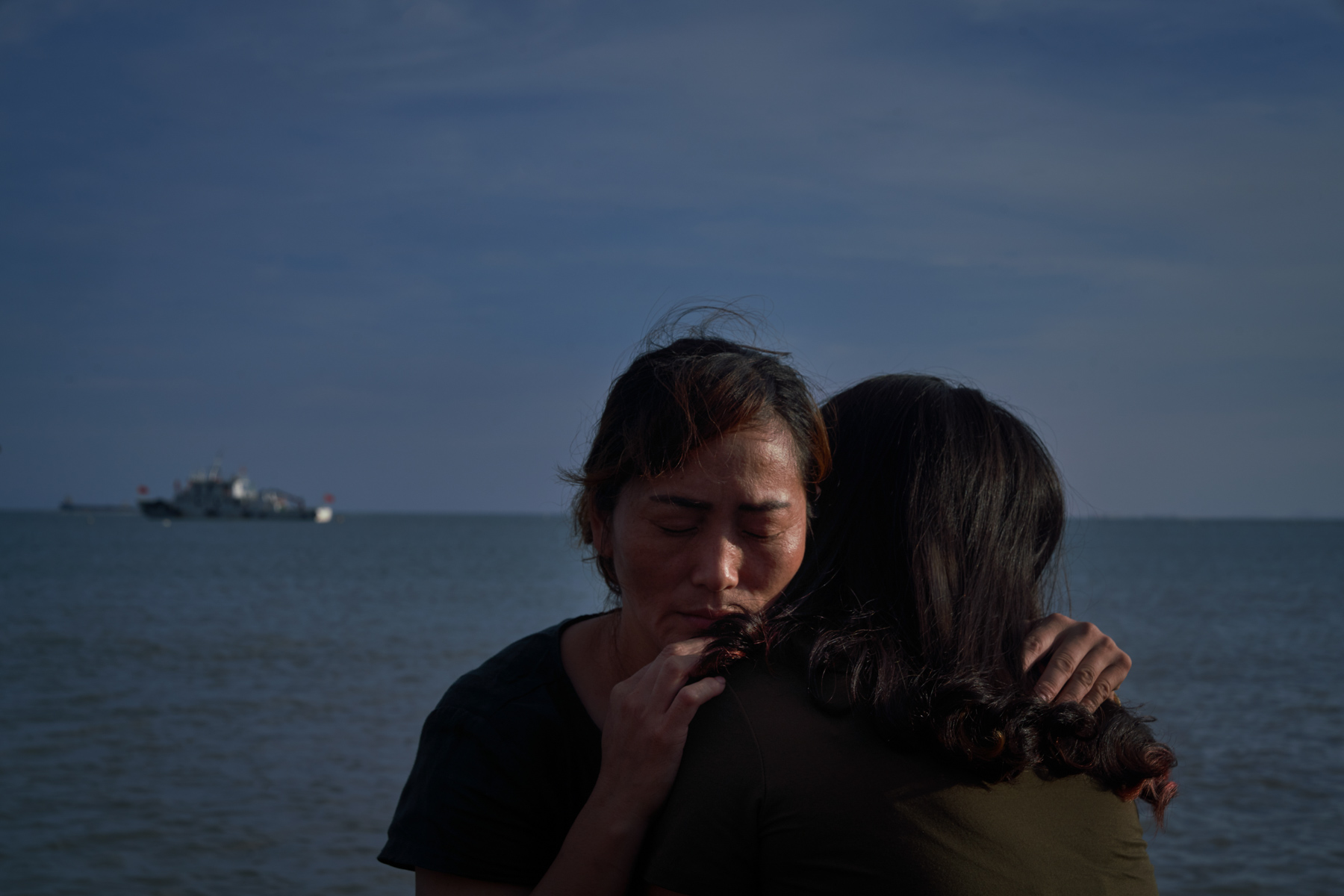 """Two women abandoned as infants hug each other, in Putian, Fujian province, June 9. Since the 1960s, thousands of infant girls have been sold from Changle to Putian, a wealthier part of Fujian 60 miles away. Some raised these girls as their own, but others treated them like maids, or """"tongyangxi,"""" pre-adolescent daughters raised to be married to their """"brothers."""" The centuries-old practice was revived between the late 1970s and 2016, when China's one-child policy was in effect. (Liang Yingfei/Ciaxin)"""