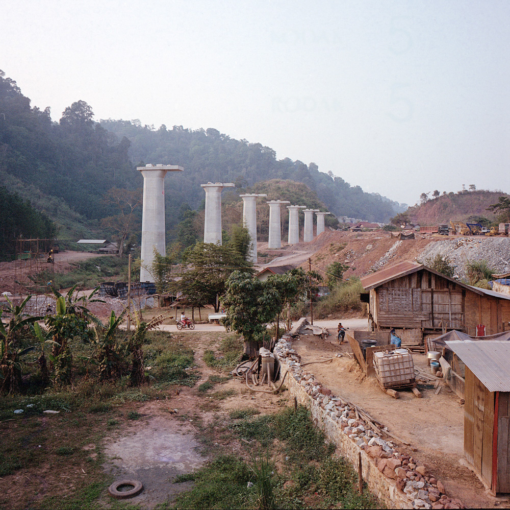 Columns for the new high-speed railway line tower over the village of New Boten in Laos near the border with China, April 10, 2019. The Chinese-built railway will connect China to Laos.