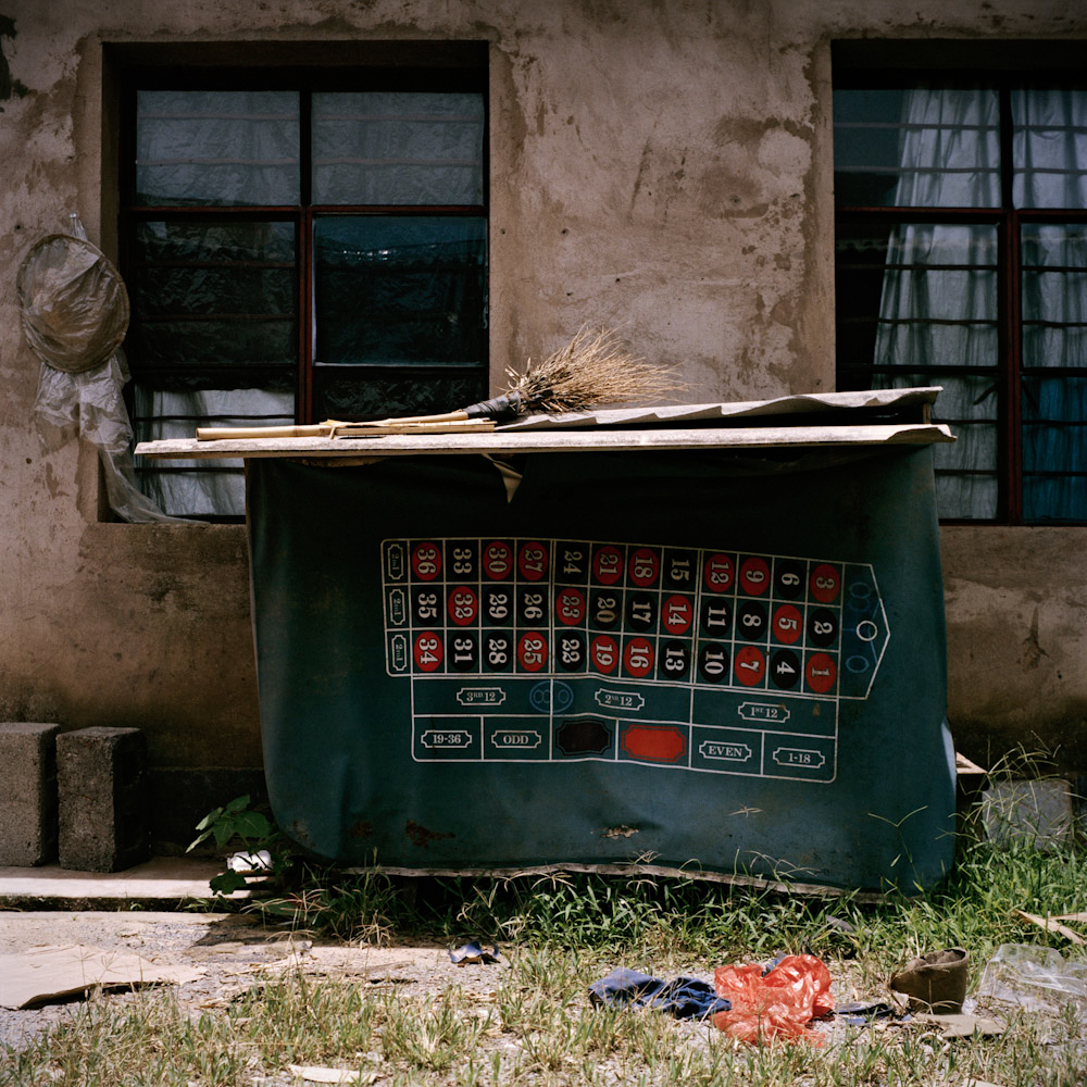 A casino table cover hangs from a shed outside an apartment for employees of the casino, in Boten, June 2011.