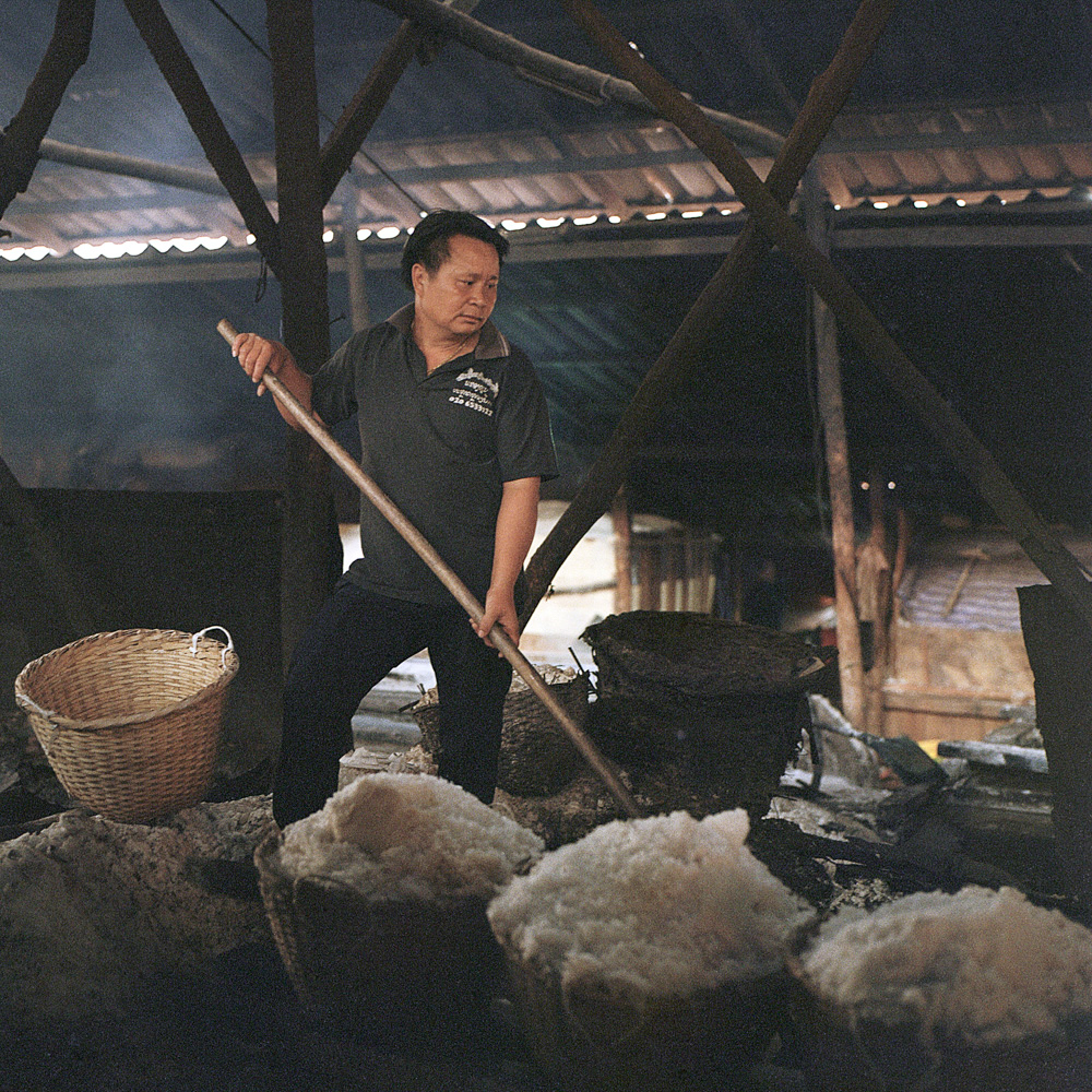 Singthong Saomany moved from a nearby province in Laos in 2005 to work in a salt factory in Boten, April 12, 2019.