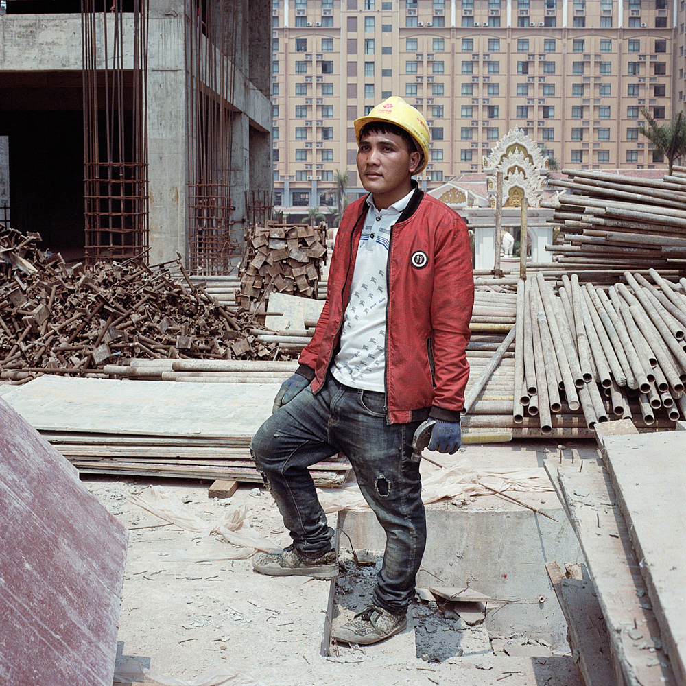 San Phanthanith moved from a nearby village to work on a Chinese-run construction site in Boten, April 14, 2019. He earns more money now than at his previous job on a banana plantation.