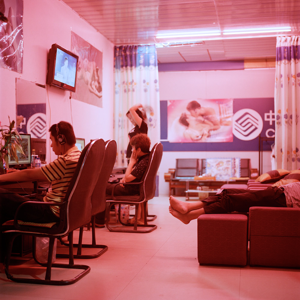 Boten residents visit an Internet cafe that doubles as a massage parlor, January 2016.