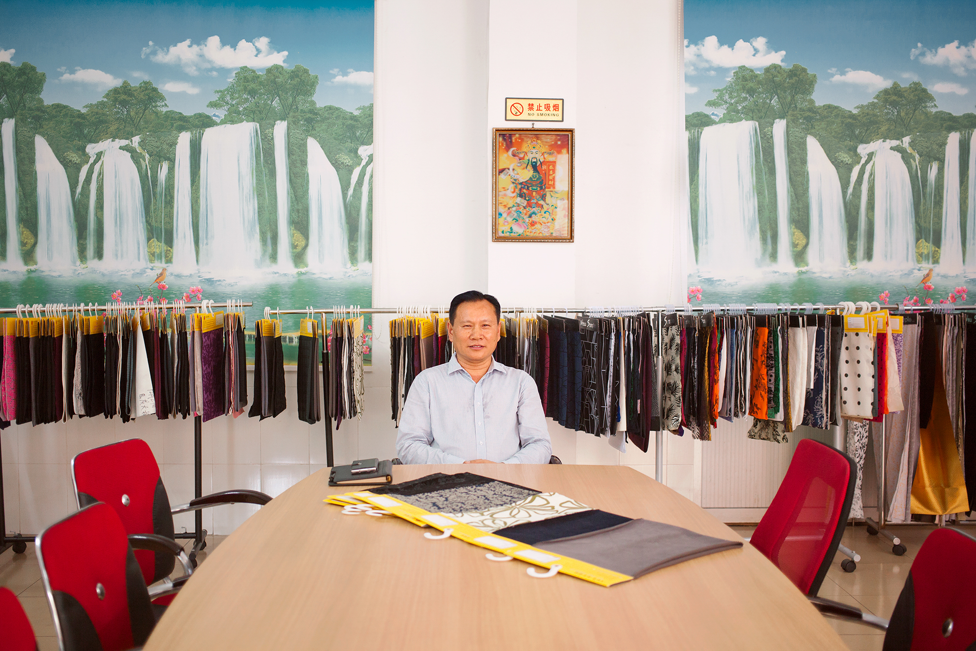 The director of a textile factory that produces custom-made fabrics for brands including Zara and Victoria's Secret, at the factory showroom, Humen town, Dongguan city, Guangdong province, China, 2016.