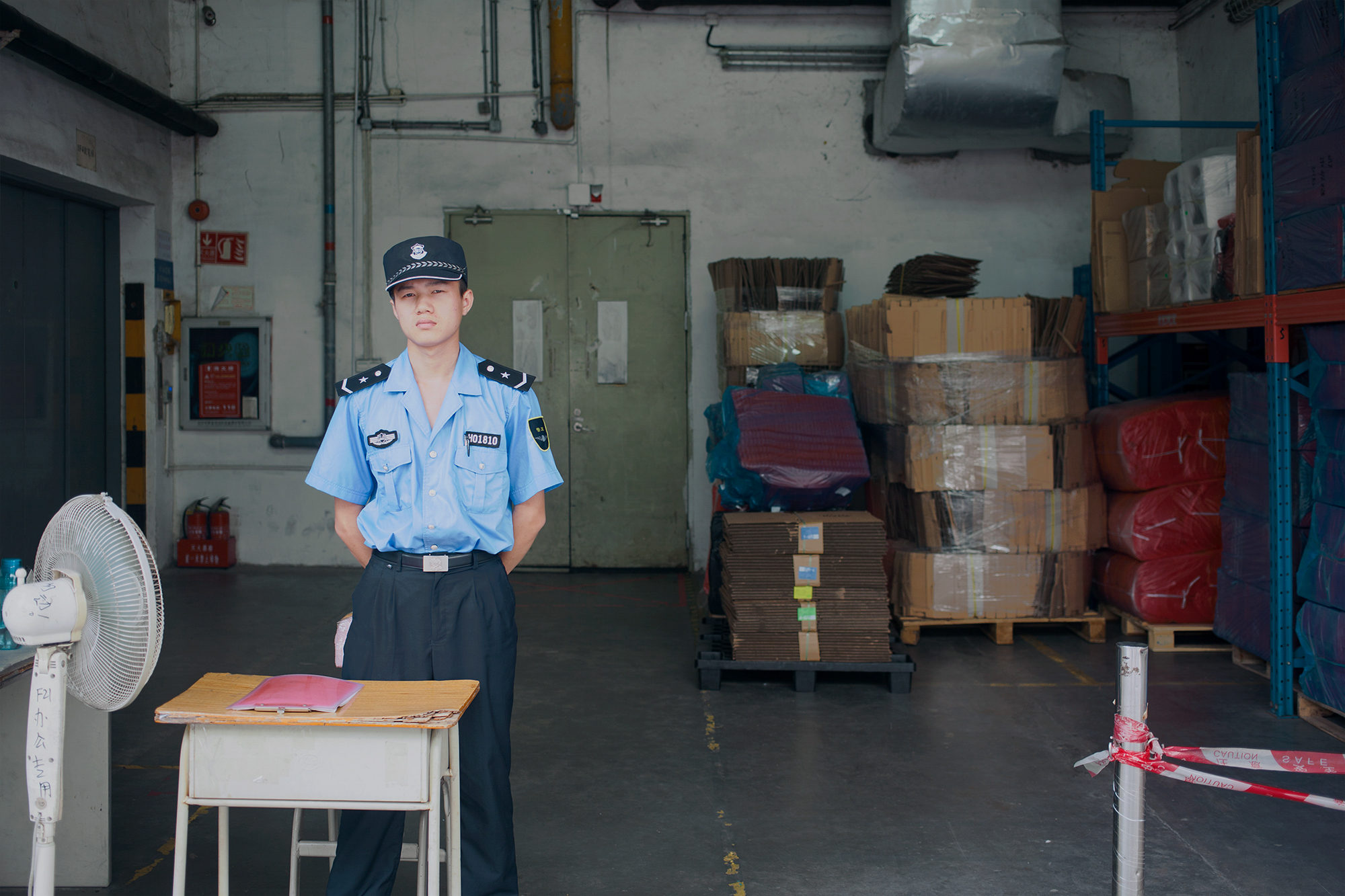A security guard at Foxconn, Shenzhen, China, 2016.