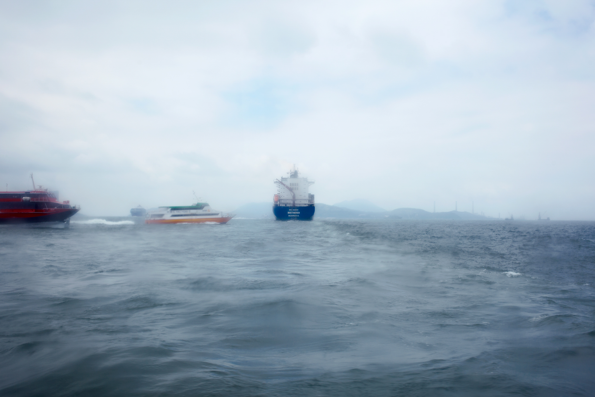 A container ship departs from the port of Hong Kong, 2016.