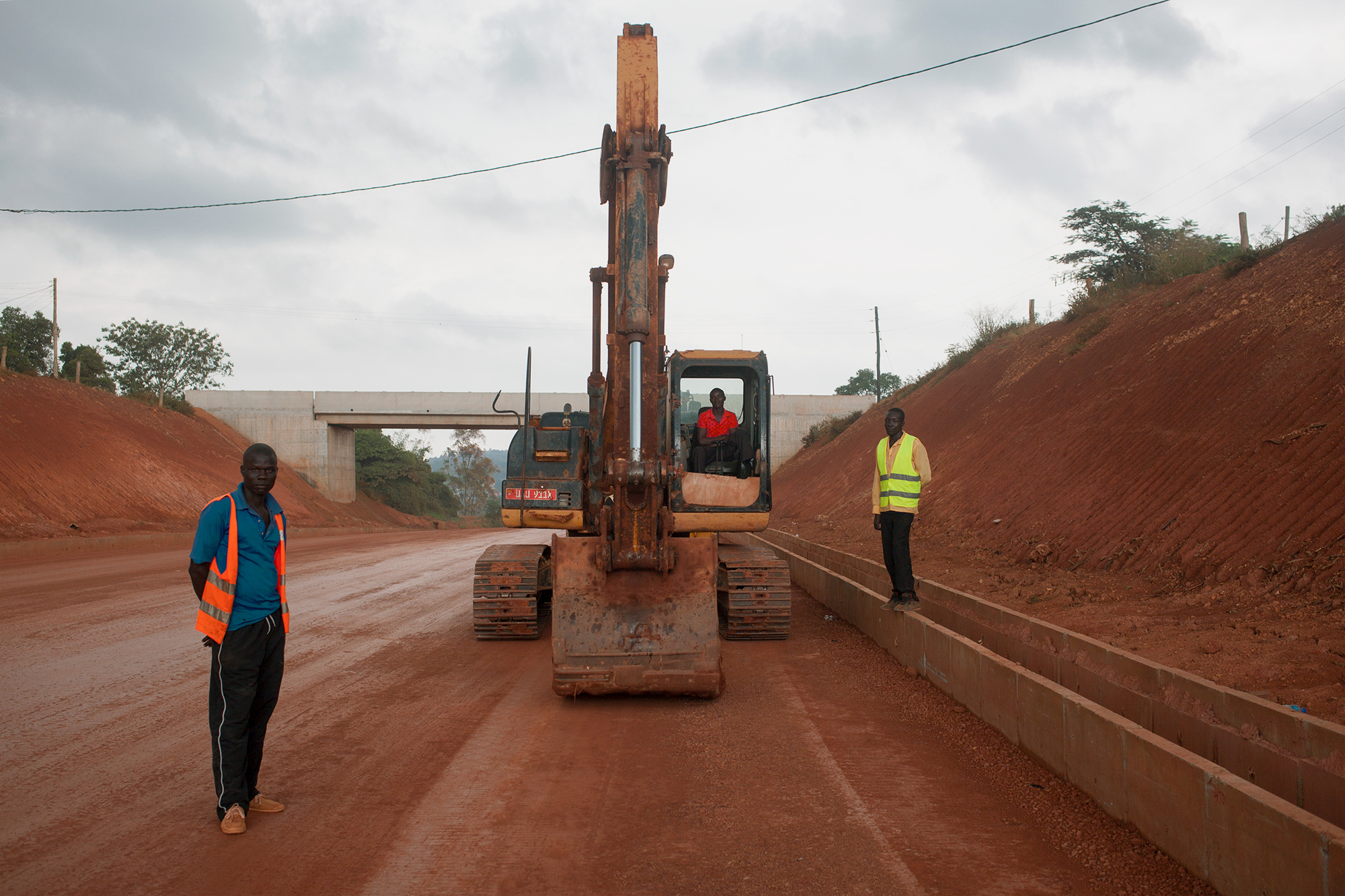 A China Communications Construction Company road construction site, between Entebbe International Airport and the city of Kampala, Uganda, 2017.