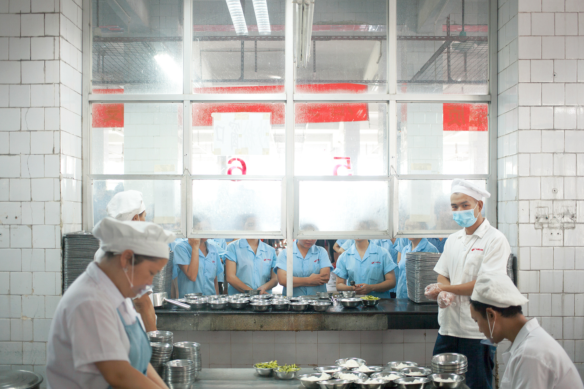 A lunch facility at a printing house for major publishers, including Penguin and Disney, on the outskirts of Shenzhen, China, 2016.
