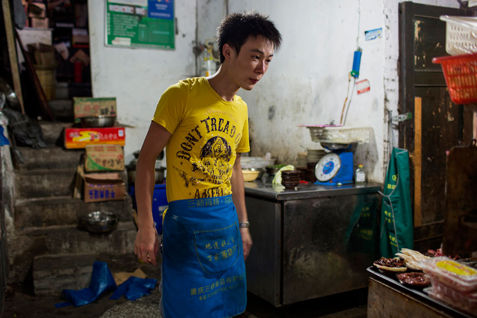 A cook inside the kitchen of An Pang Hotpot in an alley above Tiyu Road.