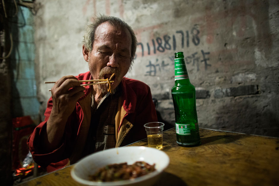 """<em>Dou gan</em>, a dish of fried noodles with peanuts and spices, is a popular dish at this small unnamed outdoor noodle cafe at the bottom of Shibati, or """"18 Steps,"""" in central Chongqing. This neighborhood dates back to the Ming Dynasty when 18 steps took residents down to a freshwater well."""