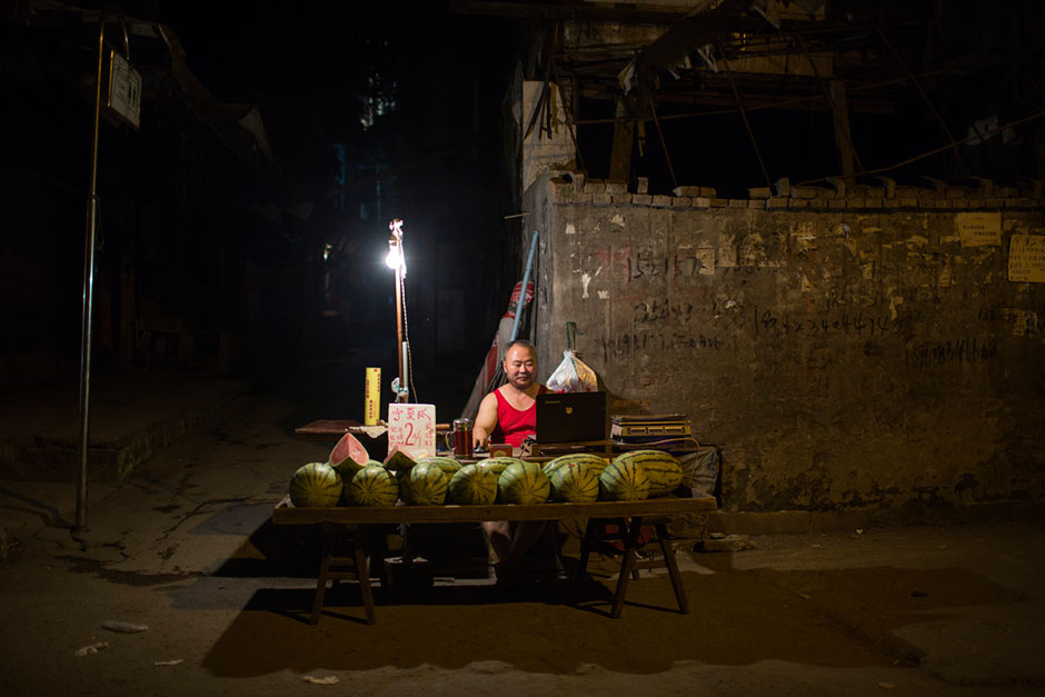 A watermelon seller waits for customers at the bottom of Shibati.