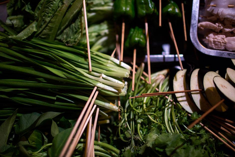 <em>Shaokao</em> ingredients prepared on skewers for diners near Shibati.