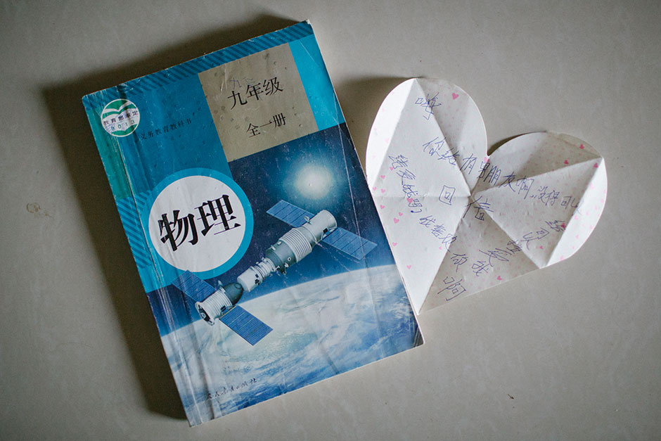 "A love letter found in a ninth-grade physics textbook at Guang's home reads, ""Hi, do you have a boyfriend? Can you accept me? I like you, please accept me. Reply."" Shuichang village, Mengla county."