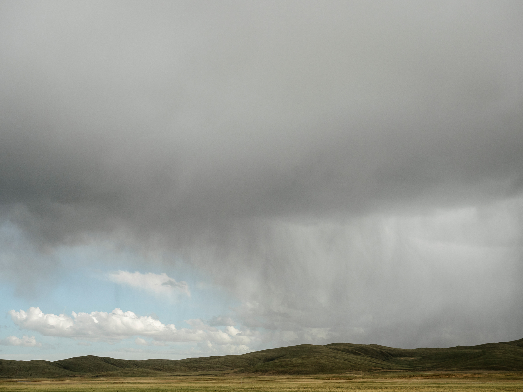 Rain clouds at an altitude above 13,000 feet, in Madoi county.