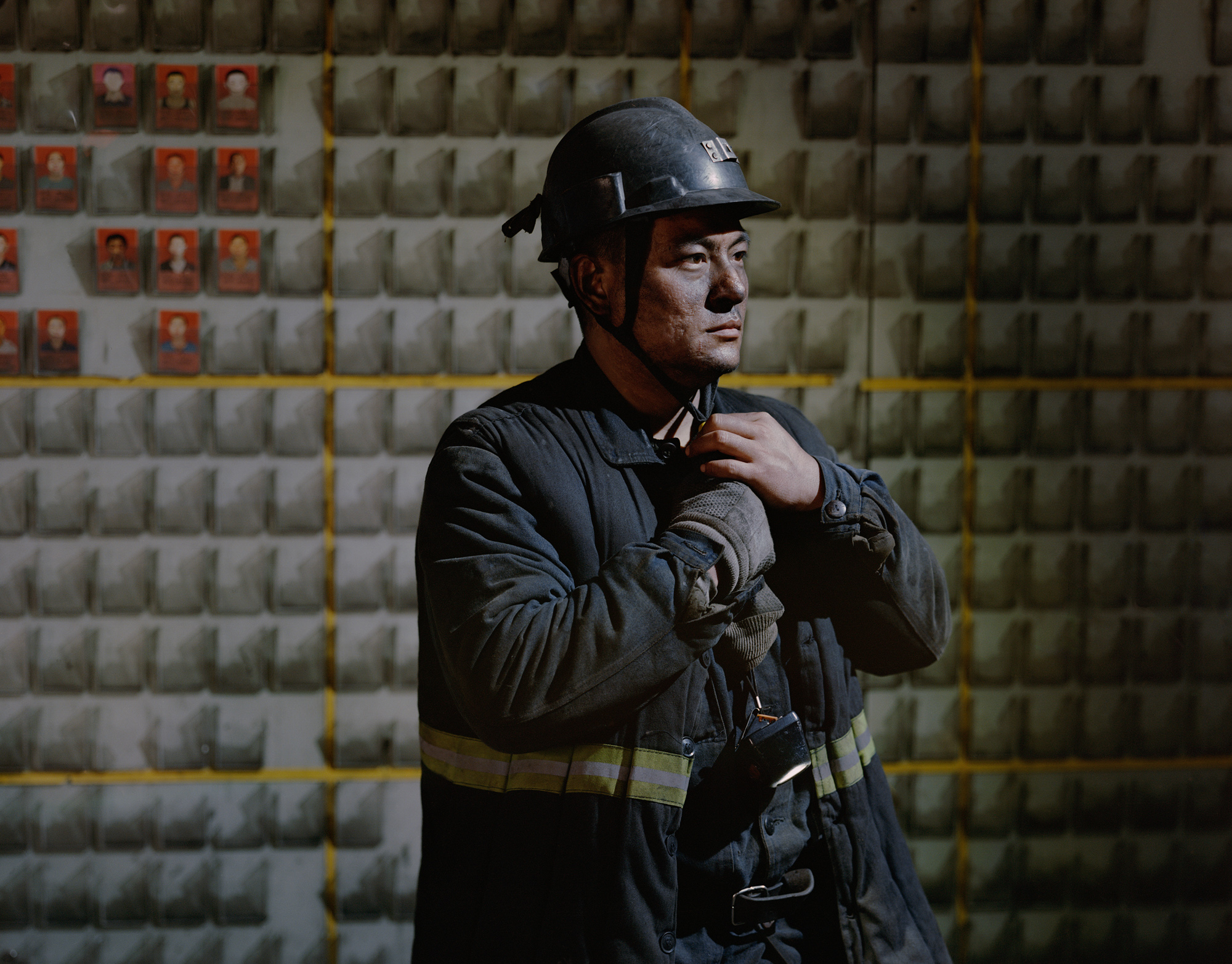 Yu Cunjiang, 31, takes off his safety helmet and gets ready for breakfast after working a 14-hour night shift in the Jinhuagong Coal Mine in Datong. Shanxi has shuttered 52 coal mines in 2016 and 2017, laying off thousands of workers in the process.