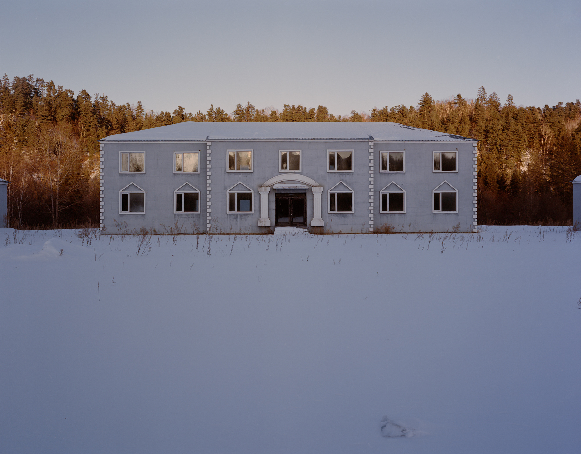 An empty office building of the local Forestry Bureau in Yichun. Beginning in 2014, China banned commercial logging in state-owned natural forests in Heilongjiang province. As a result, this office building was left unused after its construction was completed in 2013.