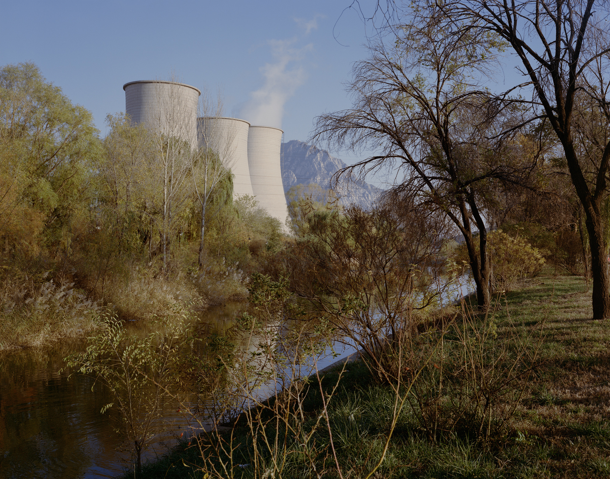 "At Xiahuayuan Power Plant, only one of three cooling towers still functions, in the city of Zhangjiakou, Hebei province, October 2017. The Xiahuayuan district of Zhangjiakou, once abundant in coal, is also on the 2013 ""resource-based cities"" list, identified as ""declining."""