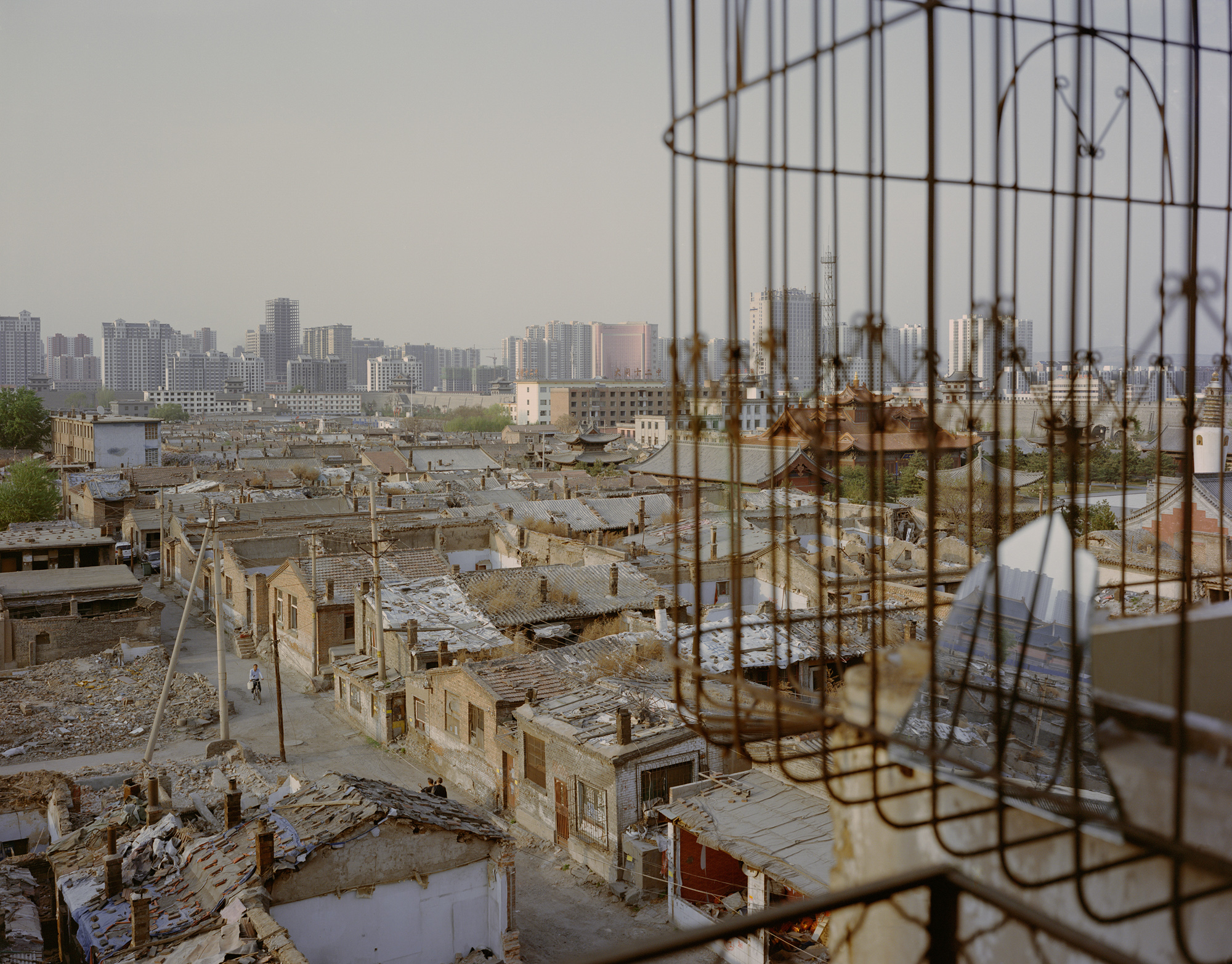 """The old town area of Datong city, labelled China's """"coal capital,"""" in northern Shanxi province, May 2017. The government designates Datong a """"mature"""" resource-based city, a city in which """"resource extraction is stable, and resource preservation is effective."""" To give the city a future not heavily reliant on coal, former Mayor Geng Yanbo sought to develop the tourism industry by recreating the """"ancient city""""––ordering the demolition of modern architecture and relocating nearly half a million residents."""