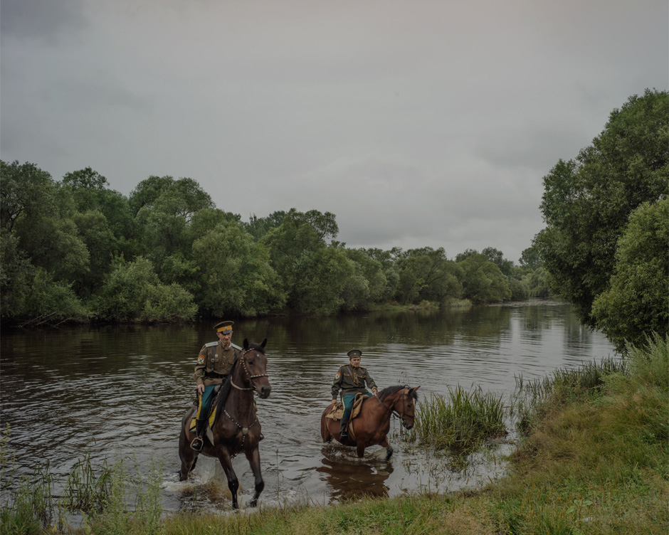 A pair of Russian Cossacks ride their horses near Moghilovka, a village in the Lazo region, where two rivers, the Amur (or Heilong, in Chinese) and Ussuri (Wusuli), form the borders of the northeastern-most corner of China's Heilongjiang province.